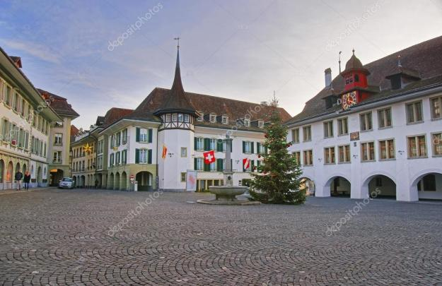 depositphotos_98190360-stock-photo-town-hall-square-with-christmas